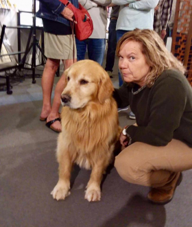 <p>Christy having fun with Bonnie's adorable Golden. </p>