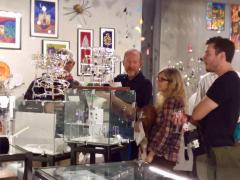 <p>Bandhu Dunham showing how his ingenius marble games work. </p>