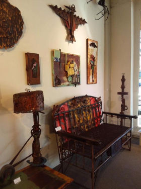<p>Kit's bench adorned by his metal wall art and sculptures.</p>