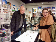 <p>John with our jeweler and dear friend, Lesley McKeown hamming it up looking at her extraordinary work.</p>