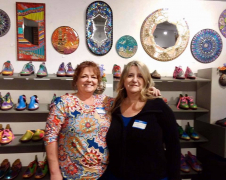 <p>JANET ALVILLAR (L) and VALERIE WATSON shown here in front of their amazing mosaic wall art.</p>