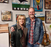<p>We always enjoy seeing Dave and Donna Newman shown here standing in front of his awesome art work.</p>