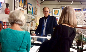 <p>The ever charming Kit Carson talking to guests about his jewelry.</p>