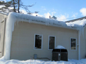 Severe ice damming due to poor roof insulation