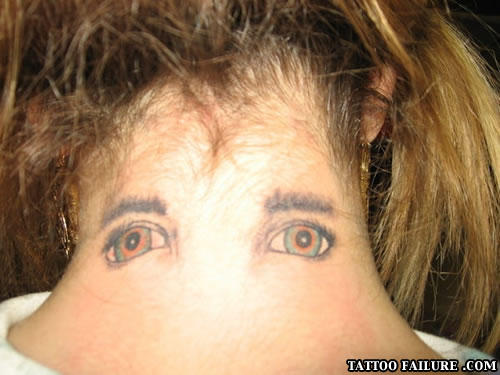 eyes on back of neck tattoo