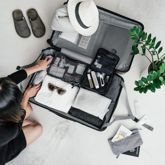 person packing a suitcase