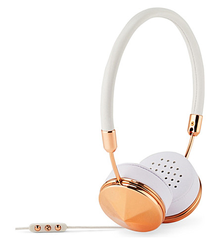 white and gold headphones