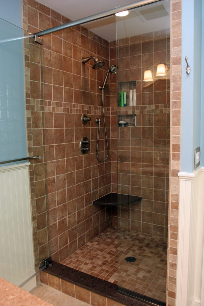 AFTER: A TILE SHOWER WITH GLASS DOOR