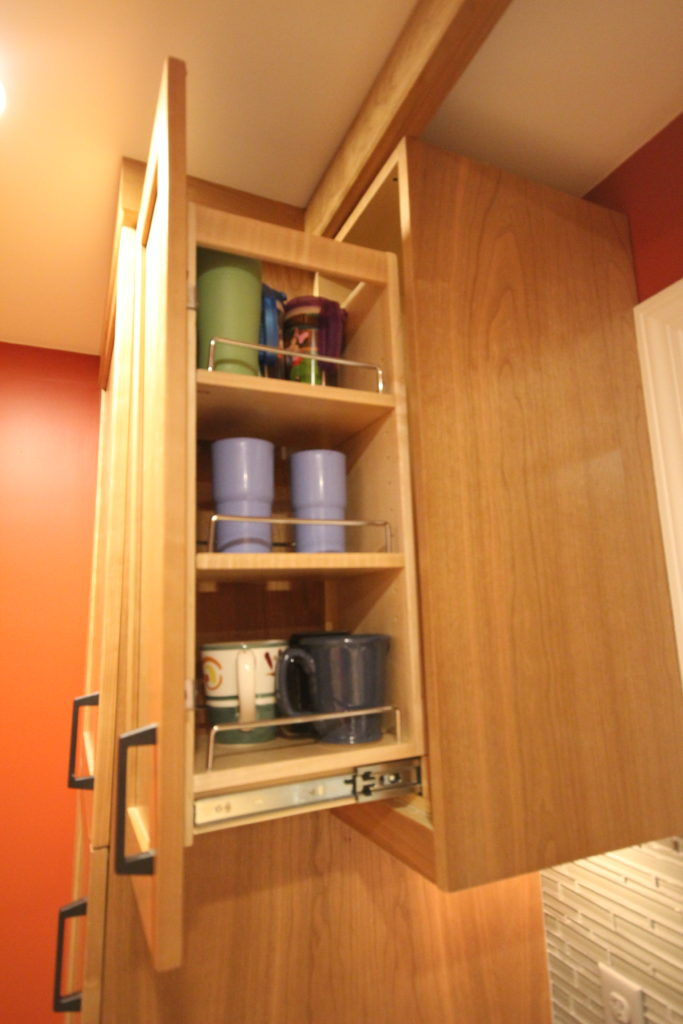 AFTER: WALL PULL OUT PANTRY FOR GLASSES AND CUPS