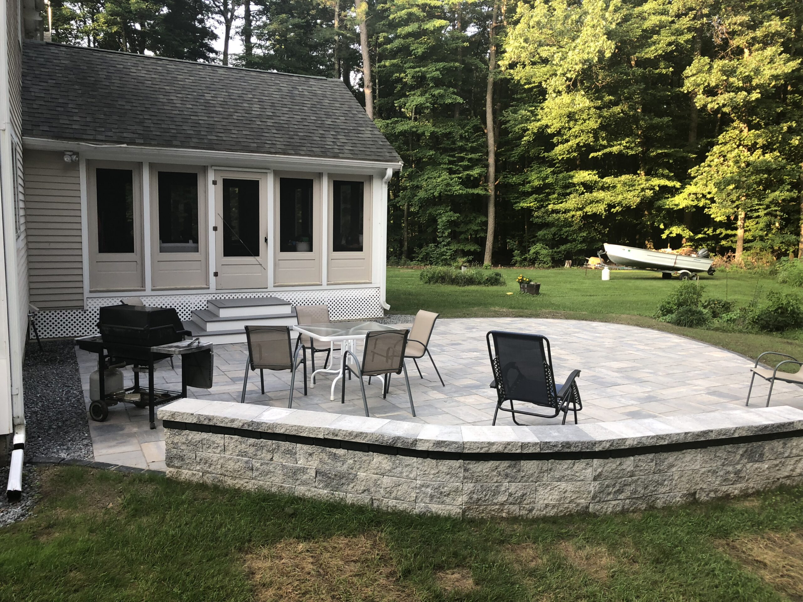 AFTER: CURVED STONE WALL FOR EXTRA SEATING SPACIOUS PATIO FOR RELAXING OR ENTERTAINING