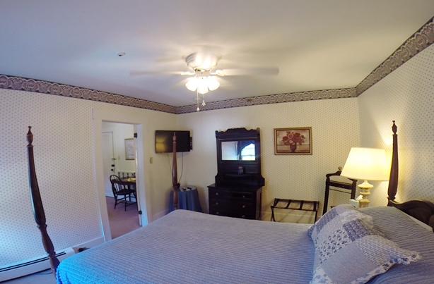 Bedroom of Black River suite at echo lake inn