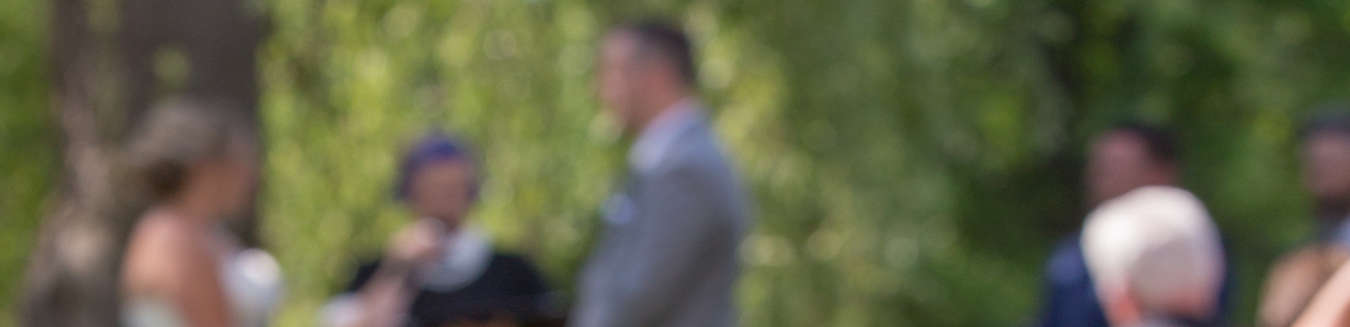 Bride and groom looking at each other in a diffused photo
