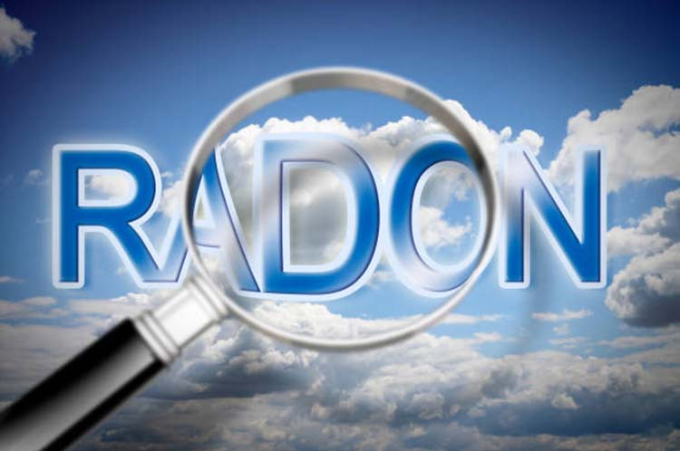 The danger of radon gas - concept image with sky, text and magnifying glass
