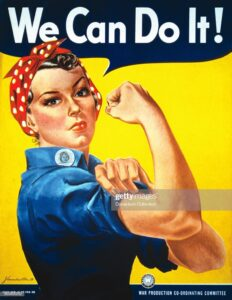A World War II color poster depicting 'Rosie the Riveter' encourages American women to show their strength and go to work for the war effort by J. Howard Miller in circa 1940. (Photo courtesy National Archives/Getty Images)