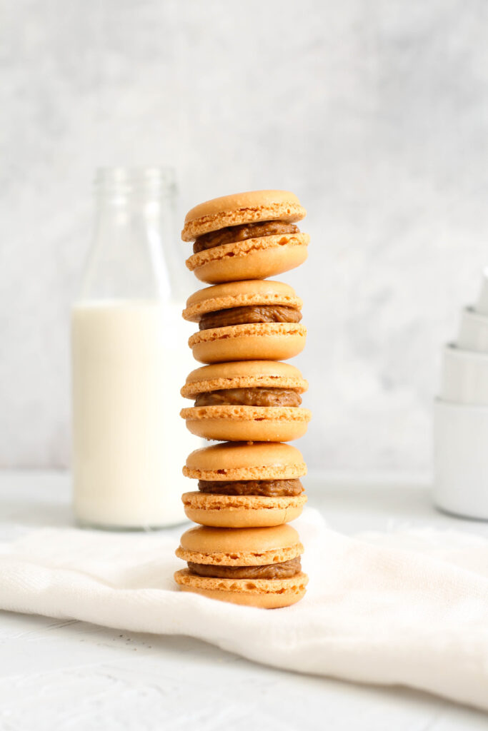 tall biscoff macaron stack with milk bottle in the backgrounf