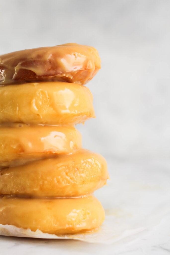 Baked donuts with caramilk ganache