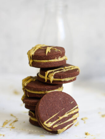 Chocolate cookies with pistachio ganache filling and milk bottle