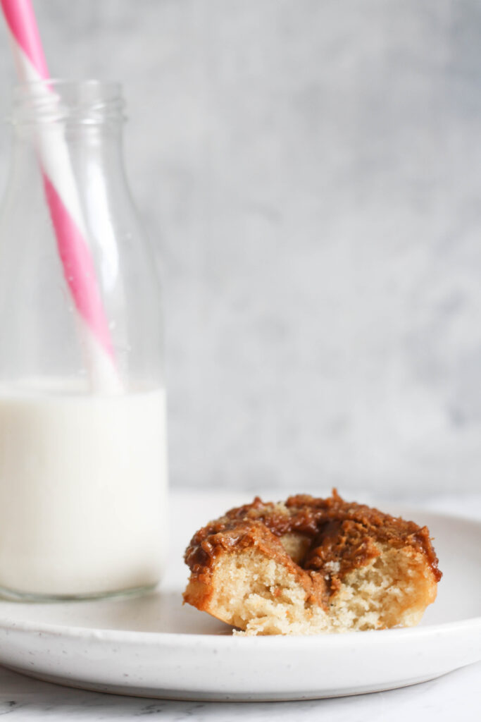 Baked biscoff donut with a bite and milk