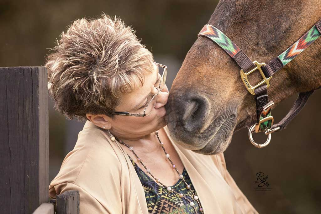 Owner Kissing Horse Muzzle at Break 'n Run Farms in Ooltewah TN