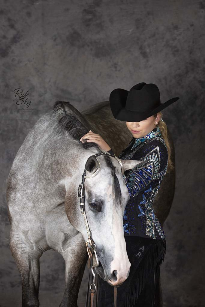 Cowgirl and western show horse captured at a horse photography workshop