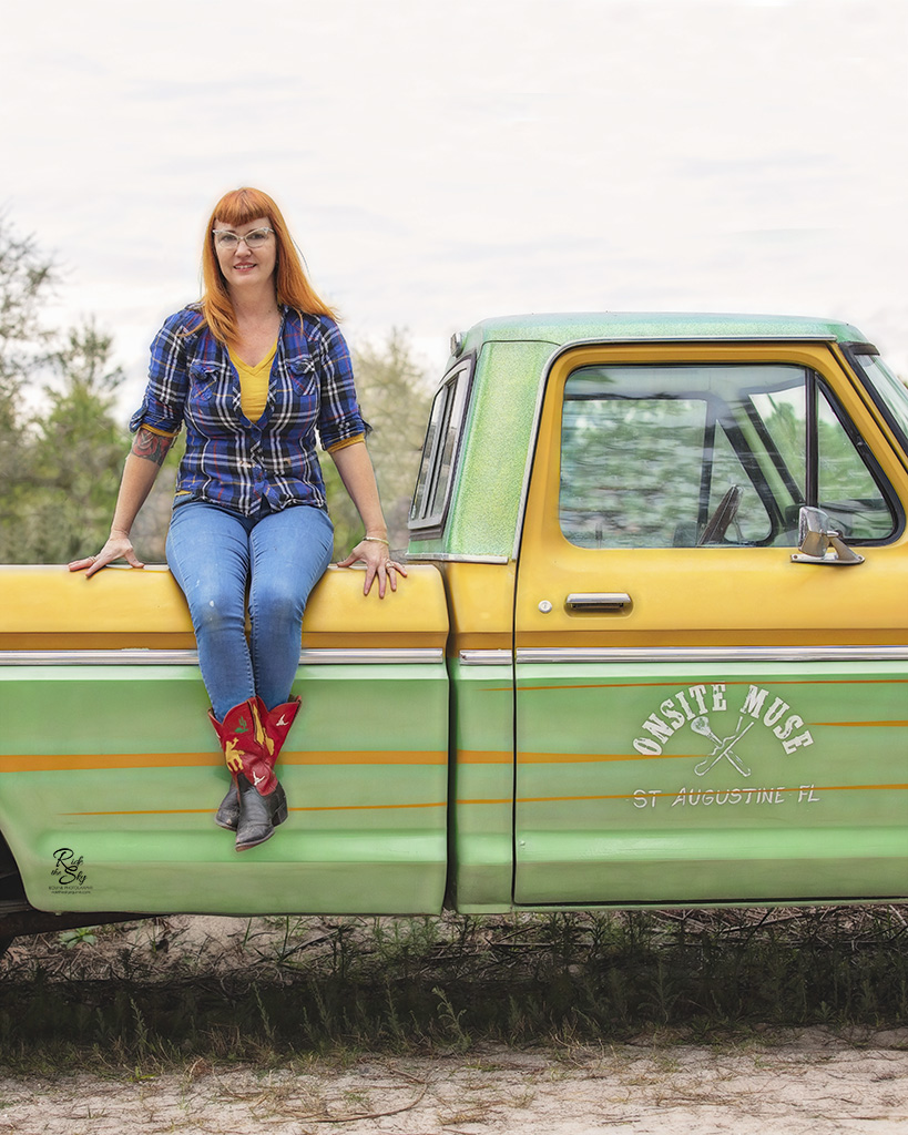 Kira McCarty of Onsite Muse sitting on her Truck in Florida