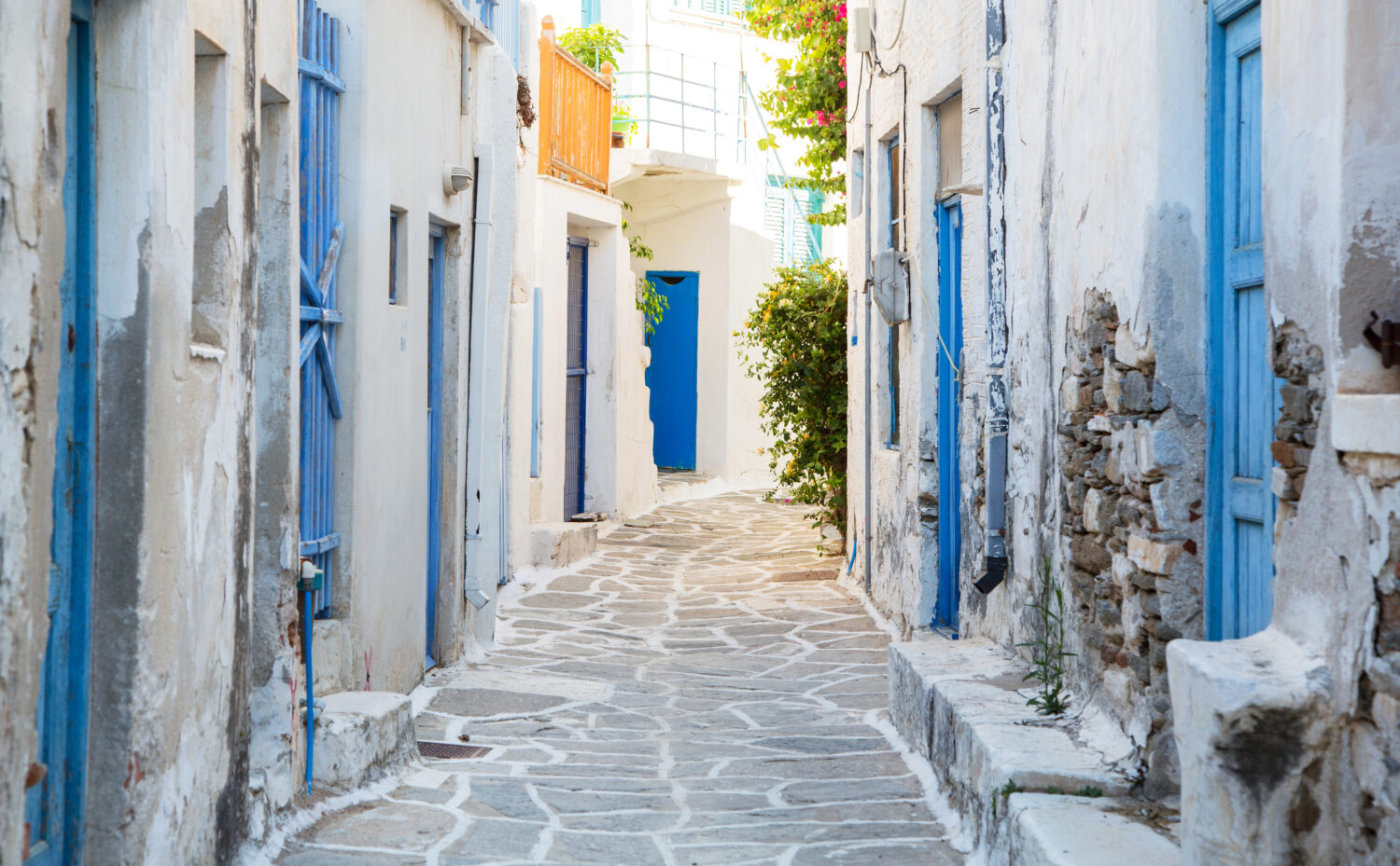 Architecture on the Cyclades. Greek Island buildings with her typical blue doors and white houses in summertime.