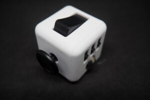 Ways the Fidget cubes is a sensory toy that help kids with Autism manage behaviors and mood in a healthy way.