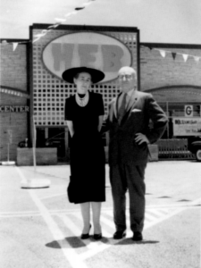 Howard Butt and his wife standing in front of H-E-B