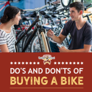 A female customer speaks with a bike shop sales representative in front of a row of bikes. Text on design reads Dos and Don'ts of Bike Buying. Learn more at https://kerrvilletri.com/2020/10/bike-buying/