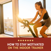 Female cyclist rides an indoor trainer. Text on design reads How to Stay Motivated on the Indoor Trainer. Read more at https://kerrvilletri.com/2020/12/stay-motivated-indoor-trainer/