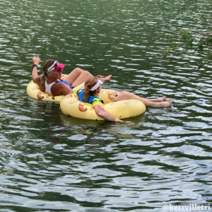 triathlon finishers float in custom Kerrville Tri Floats in the Guadalupe river after completing the triathlon