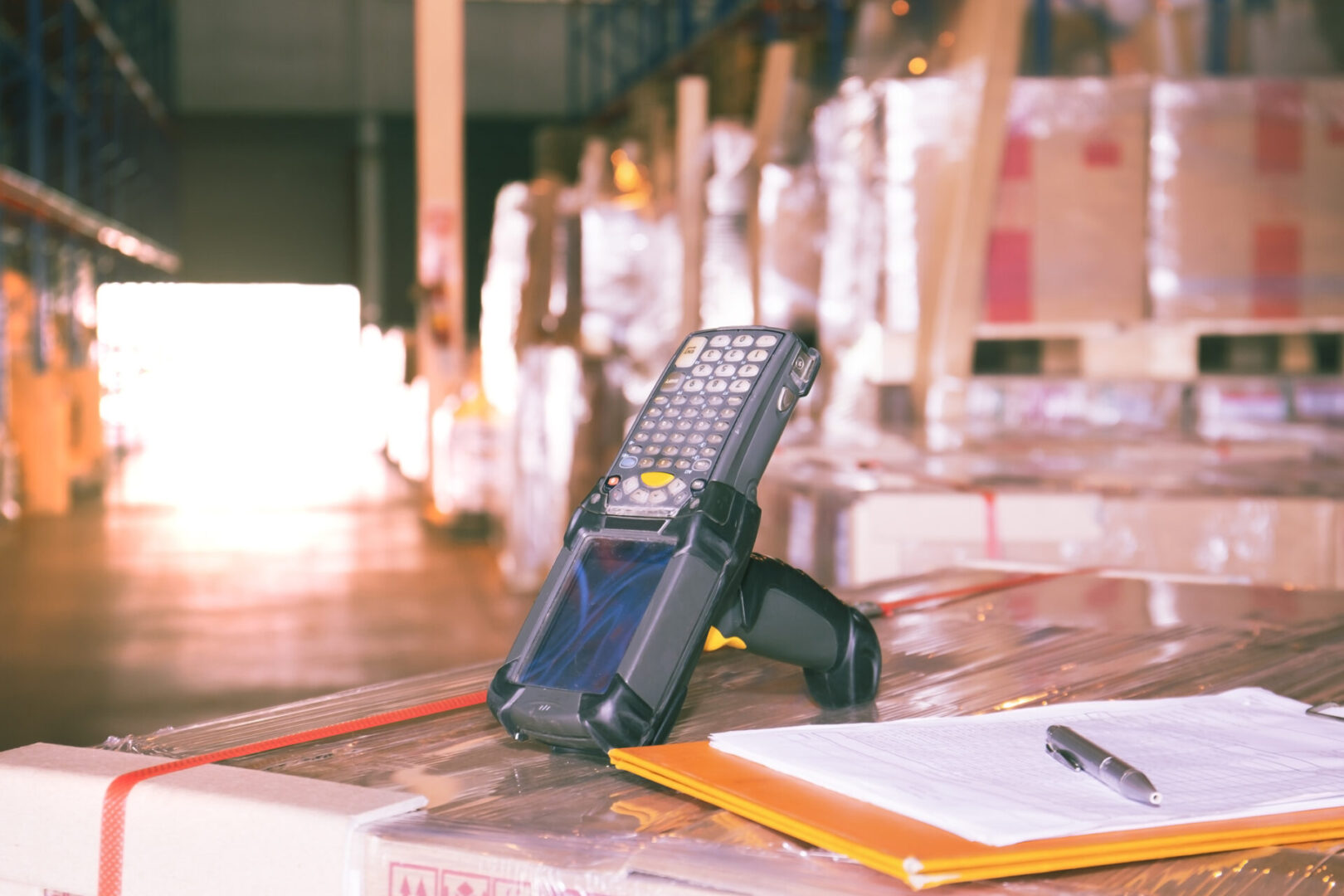 Bluetooth bar code scanner on package boxes at warehouse