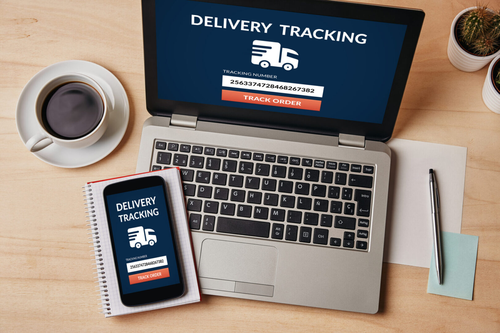 Delivery tracking concept on laptop and smartphone screen over wooden table. All screen content is designed by me. Flat lay