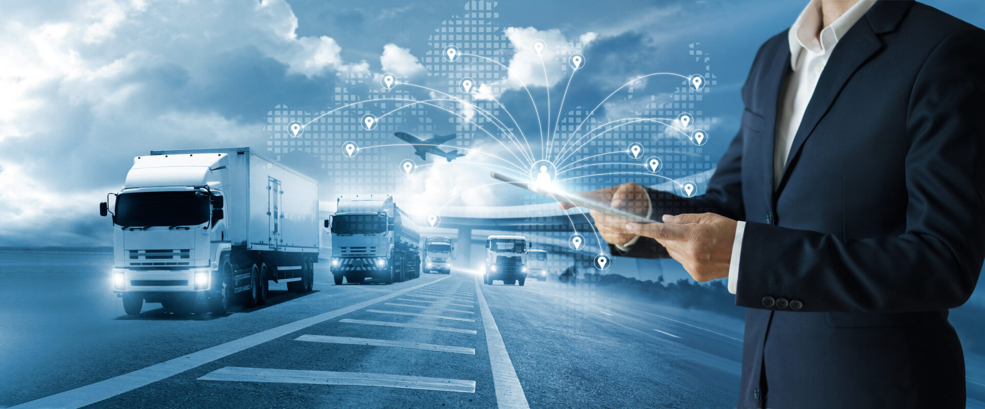 Transport and logistic concept, Freight shipping online, Businessman using tablet and data for global logistic network distribution on world map background, Business and technology, Blue tone.