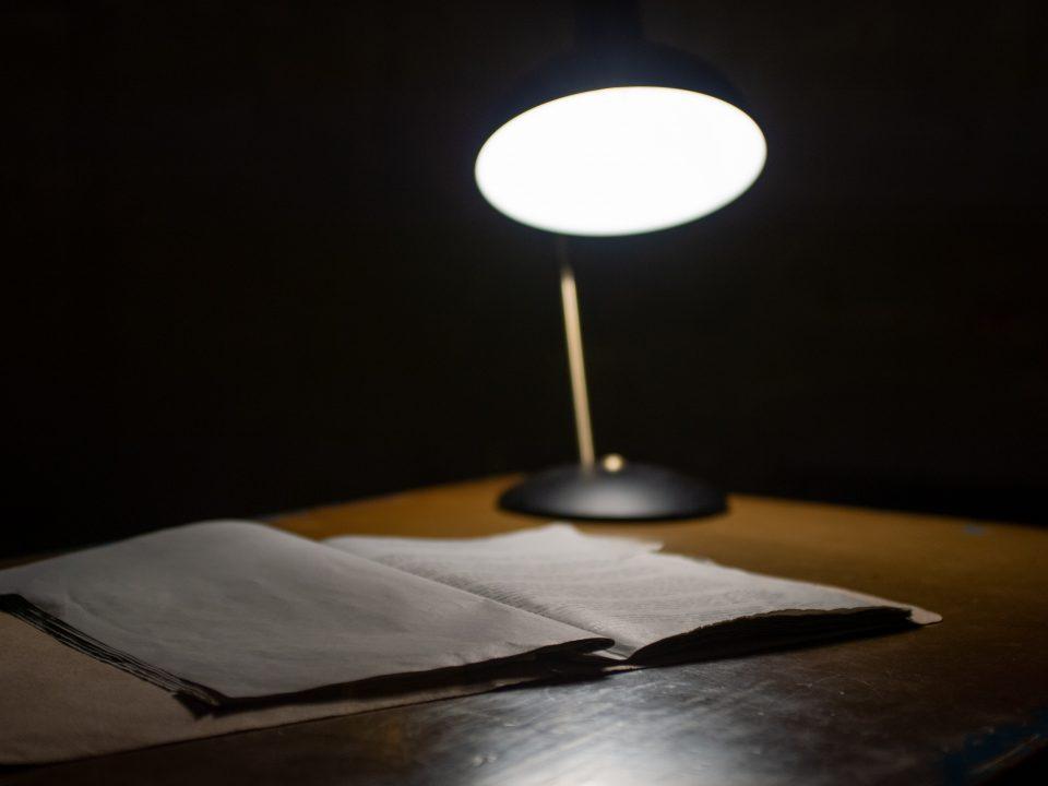 black table lamp beside book