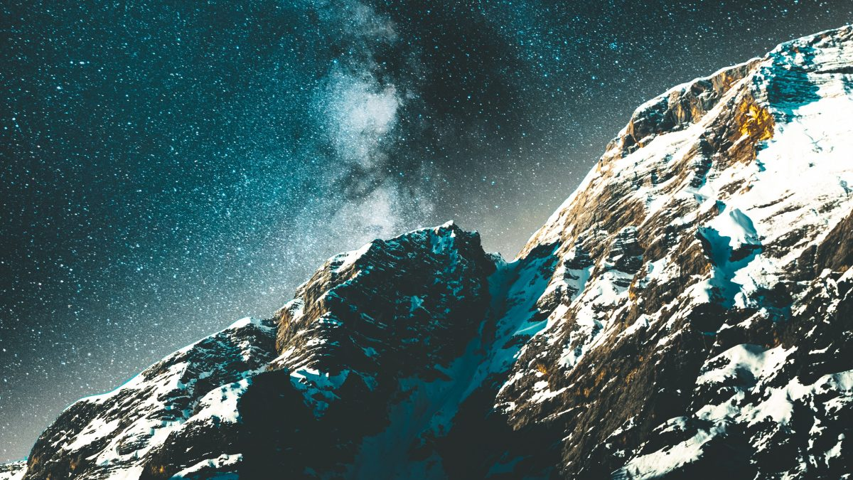 snow covered rocks at nighttime