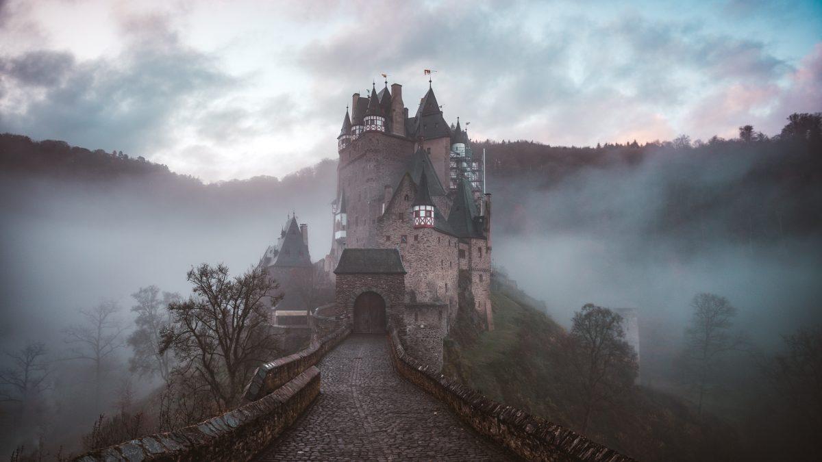 closeup photo of castle with mist