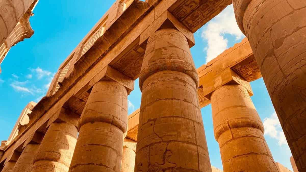 brown concrete pillars under blue sky during daytime