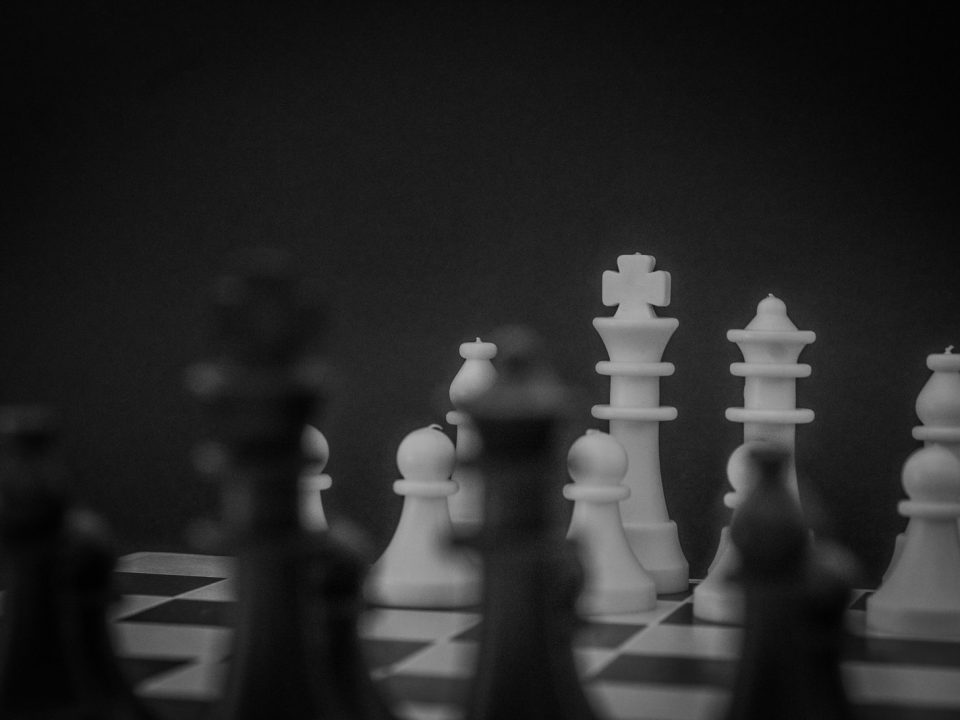 grayscale photo of a chess set