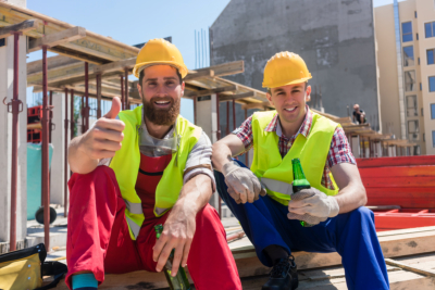 Two young workers smiling