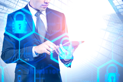 Businessman with tablet in city, cyber security