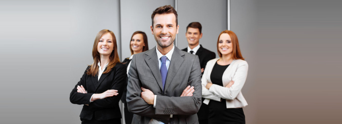 a group of businessman and woman smiling