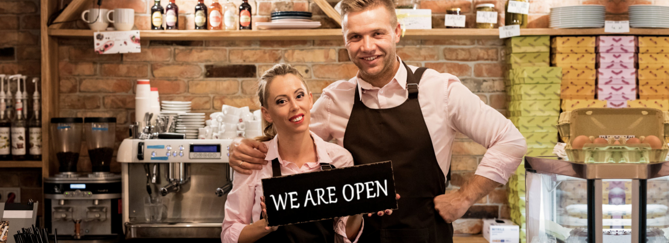 Couple In Their New Cafe Proud News Business Owners