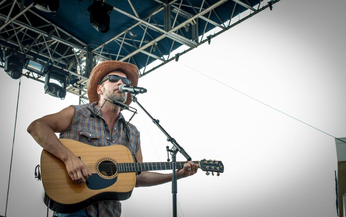 Omaha singer-songwriter Matt Cox performs at Maha Festival at Stinson Park in Omaha, Neb.