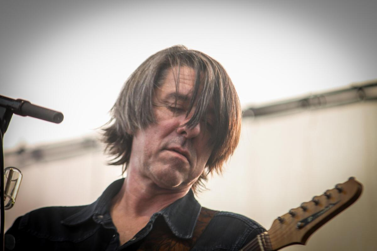 Mike Cooley of Drive-By Truckers performs at Maha Festival at Stinson Park in Omaha, Neb.