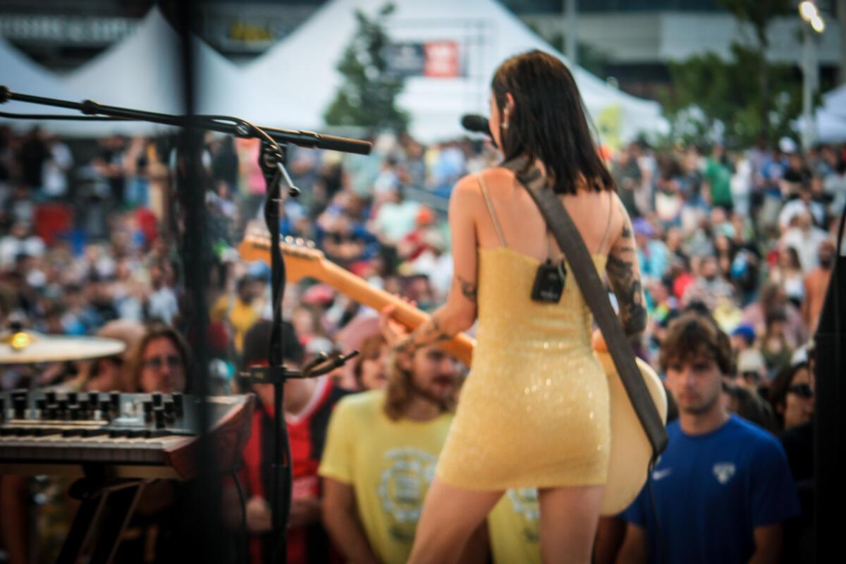 Japanese Breakfast performs to a crowd of thousands at Maha Festival at Stinson Park in Omaha, Neb.