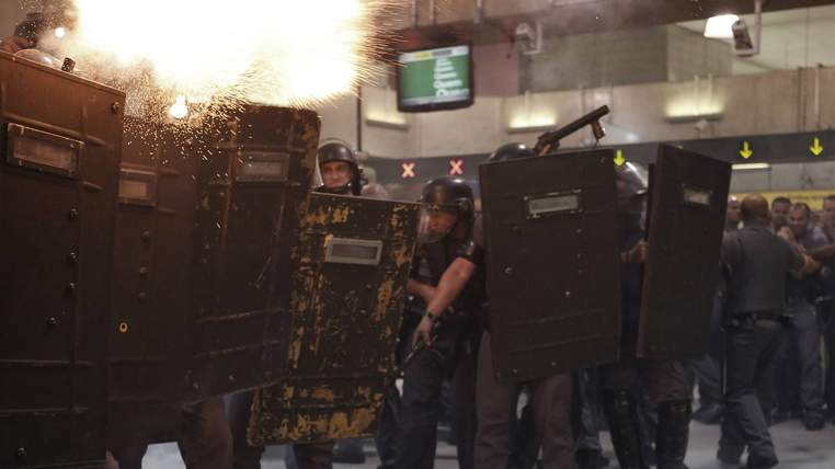 Riot police fire tear gas at demonstrators inside Faria Lima subway station during a protest against fare hikes for city buses, subway and trains in Sao Paulo January 27, 2015. REUTERS/Nacho Doce (BRAZIL - Tags: CIVIL UNREST POLITICS TRANSPORT)