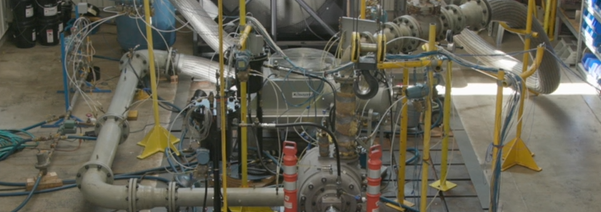 large rotary vane compressor installed inside a factory