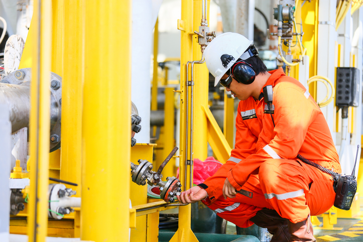 operator evaluating compressor