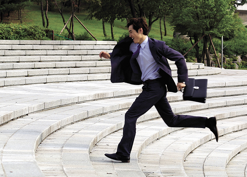 busy businessman dental patient running to appointment
